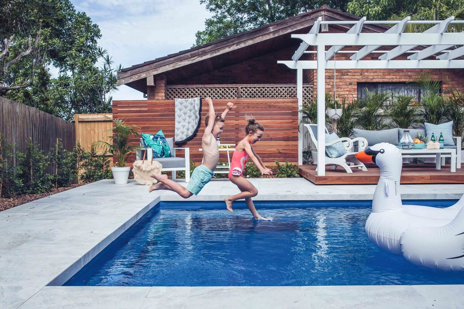 Compass Pools Sydney The pool that changes my life Kids jumping into the pool