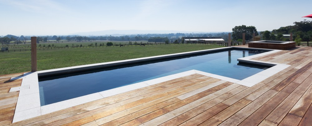 Fibreglass lap pool installation with timber decking and great views