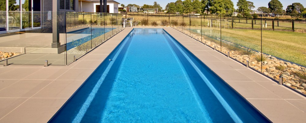 Fibreglass lap pool with glass fencing